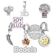 Joy de la Luz bedels en charms